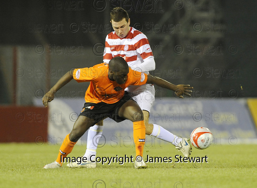 13/01/2010  Copyright  Pic : James Stewart.sct_jspa02_hamilton_v_dundee_utd  .:: MORGARO GOMIS HOLDS OFF JAMES MCARTHUR ::.James Stewart Photography 19 Carronlea Drive, Falkirk. FK2 8DN      Vat Reg No. 607 6932 25.Telephone      : +44 (0)1324 570291 .Mobile              : +44 (0)7721 416997.E-mail  :  jim@jspa.co.uk.If you require further information then contact Jim Stewart on any of the numbers above.........
