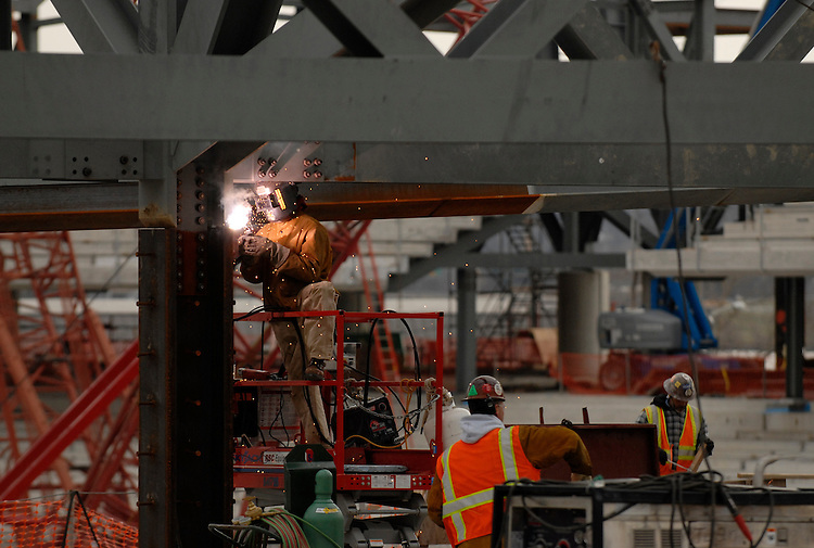 A worker welds on the site of the new baseball stadium in southeast D.C.