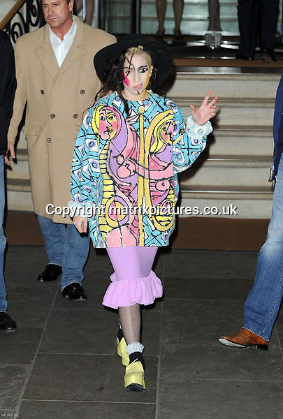 NON EXCLUSIVE PICTURE: PALACE LEE / MATRIXPICTURES.CO.UK<br /> PLEASE CREDIT ALL USES<br /> <br /> WORLD RIGHTS<br /> <br /> American pop star and singer-songwriter Lady Gaga is pictured as she leaves her hotel in central London, England.<br /> <br /> With her typical flair for creative theatrics, the 'Artpop' songstress is seen wearing an oversized 80's Culture Club style jacket with matching Cubism-styled face paint, a wide-brimmed black hat, purple skirt and small yellow wedges.<br /> <br /> DECEMBER 6th 2013<br /> <br /> REF: LTN 137783