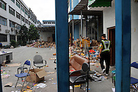 A security guard walking in the closed factory belonging to Smart Union, one of several factories in Zhang Mutou in South China that went bankrupt in the current credit crisis. Smart Union, that produced toys for Mattel amongst others, left 6,000 workers jobless and penniless after they could not pay the salaries. Hundreds of factories in South China are closing due to increased labor and material costs and the current credit crissis is exasperating. The problem leaving ghost towns behind. .24 Oct 2008