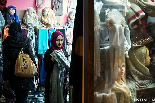 People shop in Brussels' Molenbeek neighbourhood, a hotbed of Islamic radicalism.
