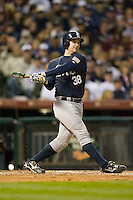 Doug Simmons #38 of the Rice Owls follows through on his swing versus the Texas A&M Aggies in the 2009 Houston College Classic at Minute Maid Park February 28, 2009 in Houston, TX.  The Owls defeated the Aggies 2-0. (Photo by Brian Westerholt / Four Seam Images)