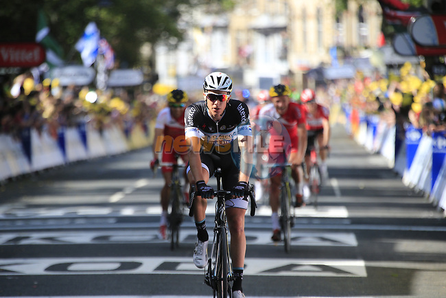 Riders cross the finish line of Stage 1 of the 2014 Tour de France running 190.5km from Leeds to Harrogate. 5th July 2014.<br /> Picture: Eoin Clarke www.newsfile.ie