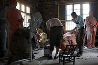 "Workers craft a statue of Mao Zedong out of resin at the workshop of a ""Red"" memorabilia collector and manufacturer, near Mao's birthplace in Shaoshan, Hunan Province, China on 12 August 2009.  The workers were once electricians."
