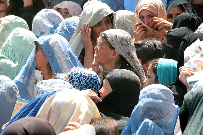 A group of women wait to receive free medical assistance, food staples and winter clothes from U.S. troops and Afghan police in Kandahar, Afghanistan. Aug. 18, 2008. DREW BROWN/STARS AND STRIPES
