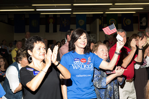 September 20, 2014. Greensboro, North Carolina.<br />  The crowd cheered as Mark Walker led the stage after his speech.<br />  Thom Tillis and Mark Walker hosted a rally at the Guilford County Republican Party headquarters for their supporters in the upcoming November election. Tillis, the current Speaker of the House for the NC House of Representatives, is running to take Democrat Kay Hagan's US Senate seat, while Walker, a local pastor, is running for the NC 6th District' s US Congressional seat.