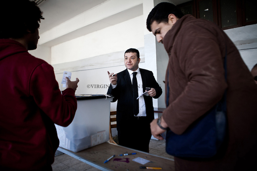 EGYPT, Cairo: A judge of a polling station in Nasr City district of Cairo gives guidance to voters. NGUYEN HOANG VIRGINIe/HANSLUCAS/HUMA