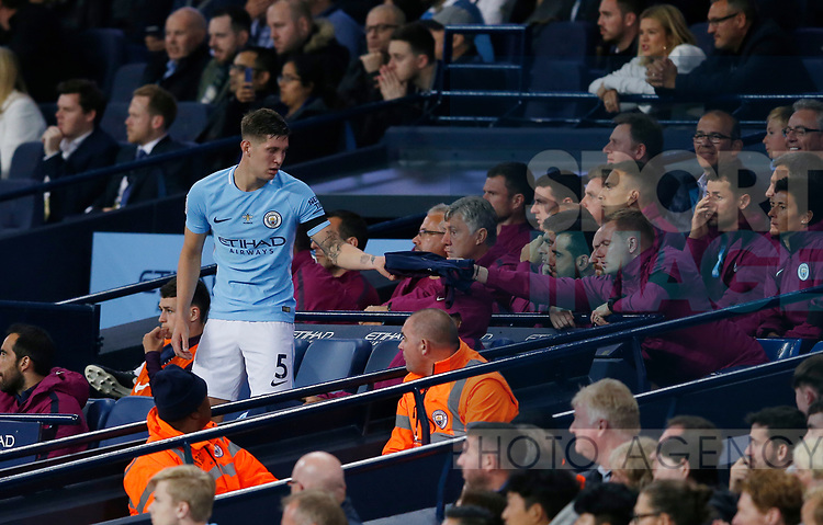 John Stones of Manchester City sits down after being substituted during the Premier League match at the Eithad Stadium, Manchester. Picture date 21st August 2017. Picture credit should read: Simon Bellis/Sportimage