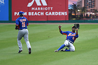 New York Mets outfielder Curtis Granderson (3) makes a sliding catch as Ruben Tejada (11) looks on during a Spring Training game against the St. Louis Cardinals on April 2, 2015 at Roger Dean Stadium in Jupiter, Florida.  The game ended in a 0-0 tie.  (Mike Janes/Four Seam Images)