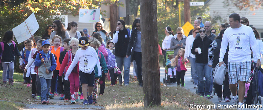 Flaherty School students walk from St. Catherine Greek Orthodox Church to Flaherty School in Braintree during International Walk to School Day on Friday October 10, 2014.(Photo By Gary Wilcox)