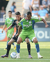 Sebastien Le Toux #9 of the Philadelphia Union grabs onto Tyrone Marshall #14 of the Seattle Sounders FC during the first MLS match at PPL stadium in Chester, PA. on June 27 2010. Union won 3-1.