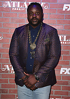 "LOS ANGELES - FEBRUARY 19:  Brian Tyree Henry at the red carpet event for FX's ""Atlanta Robbin' Season"" at the Ace Theatre on February 19, 2018 in Los Angeles, California.(Photo by Scott Kirkland/FX/PictureGroup)"