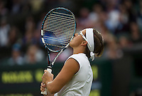 02-07-13, England, London,  AELTC, Wimbledon, Tennis, Wimbledon 2013, Day eight, Kirsten Flipkens (BEL) kissing her racket after she hits a winner<br /> <br /> <br /> <br /> Photo: Henk Koster