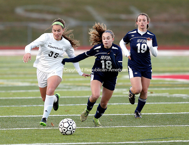 Southbury, CT- 11 November 2016-111116CM13- Pomperaug's Jamie Collimore left, goes after the ball against Avon's Riley Abate and Ariel Birkenruth during their state tournament matchup on Friday.     Christopher Massa Republican-American