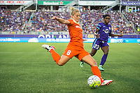Orlando, Florida - Saturday, April 23, 2016: While pressured by Orlando Pride forward Jasmyne Spencer (23), Houston Dash defender Ellie Brush (8) plays the ball up field during an NWSL match between Orlando Pride and Houston Dash at the Orlando Citrus Bowl.