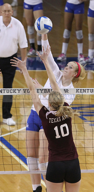 Sophomore Outside Hitter Lauren O'Conner (12) spikes the ball during the University of Kentucky vs. Texas A&M volleyball match at Memorial Coliseum in Lexington, Ky., on Sunday, October 14, 2012. Photo by Jared Glover | Staff