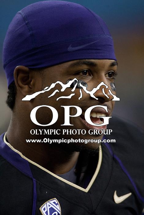NOV 10, 2012: Washington's #17 Keith Price takes a breather on the sidelines against Utah.  Washington won 34-15 over Utah at CenturyLink Field in Seattle, WA...