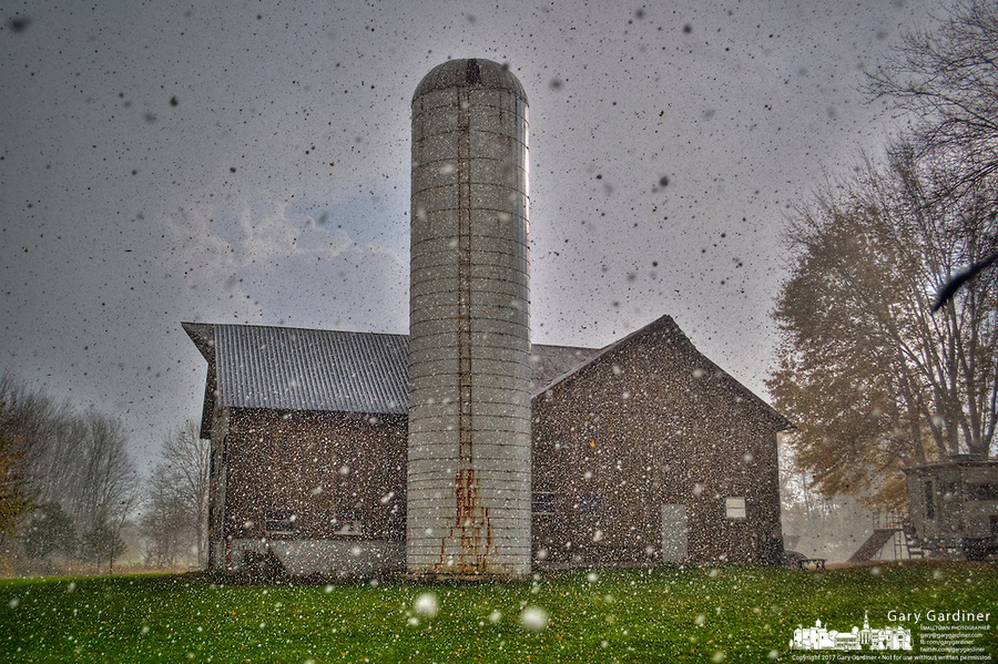 Hail falls at the edge of a storm over a Westerville, Ohio, barn on a warm fall day.