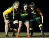 Abigail Timmins, center, works on scrum formations with Kari Kyrkjeboe Fredheim, left, and Sarah Klecher during LIU Post women's rugby practice held on campus on Wednesday, Feb. 21, 2018.
