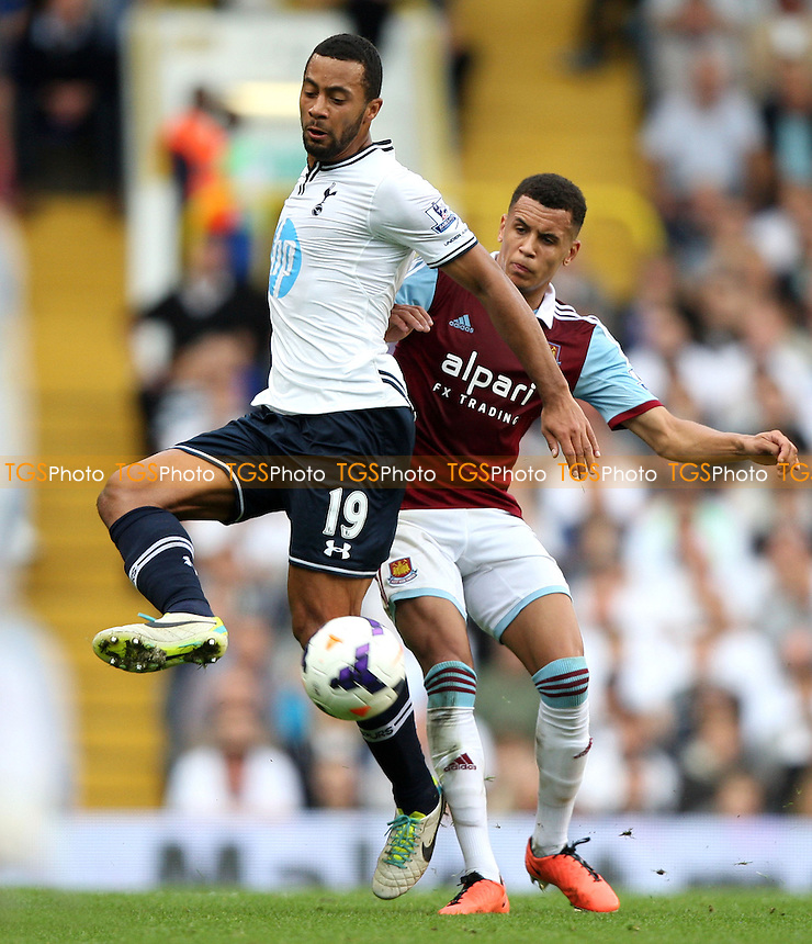 Mousa Dembele of Spurs and Ravel Morrison of West Ham - Tottenham Hotspur vs West Ham United, Barclays Premier League at White Hart Lane, Tottenham - 06/10/13 - MANDATORY CREDIT: Rob Newell/TGSPHOTO - Self billing applies where appropriate - 0845 094 6026 - contact@tgsphoto.co.uk - NO UNPAID USE