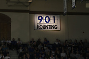 A sign in the corner of the stadium displays head coach Mike Krzyzewski's number of wins. Tonight was win number 902 for Duke head coach Mike Krzyzewski, tying him with Bob Knight for the NCAA Division I all-time win record. Photo by Al Drago.