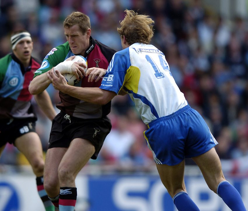 Photo: Richard Lane..Montferrand  v NEC Harlequins. Parker Pen Challenge Cup Final. 22/05/2004..Will Greenwood is tackled by Aurelien Rougerie.