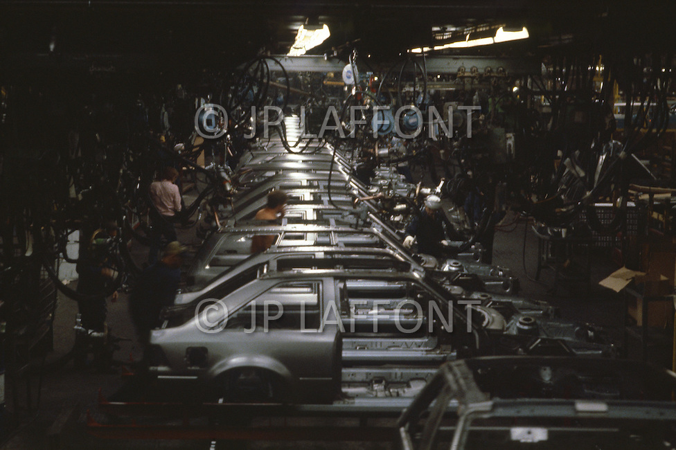 Detroit, U.S.A, December, 1980. Body assembly line of Ford Escort, the first compact car manufactured in the US.