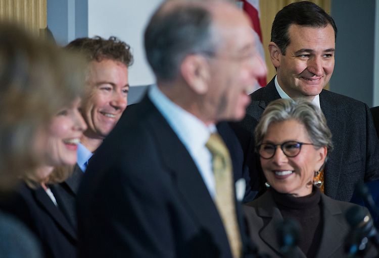 UNITED STATES - NOVEMBER 06: From left, Sens. Kirsten Gillibrand, D-N.Y., Rand Paul, R-Ky., Chuck Grassley, R-Iowa, Barbara Boxer, D-Calif., and Ted Cruz, R-Texas, conduct a new conference in Russell Building on creating a military justice system that would lessen the intimidation that military sexual assault victims feel when coming forward about a crime committed against them. (Photo By Tom Williams/CQ Roll Call)