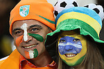 20 JUN 2010: Ivory Coast fan and a Brazil fan pose together. The Brazil National Team defeated the C'ote d'Ivoire National Team 3-1 at Soccer City Stadium in Johannesburg, South Africa in a 2010 FIFA World Cup Group G match.