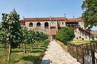Pictures & images of the vineyard and refectory  of the medieval Alaverdi St George Cathedral & monastery complex, 11th century, near Telavi, Georgia (country). <br /> <br /> At 50 meters high Alaverdi St George Cathedral was once the highest cathedral in Georgia (now its the nes Tblisi cathedral). The cathedral is part of a Georgian Orthodox monastery founded by the monk Joseph [Abba] Alaverdeli, who came from Antioch and settled in Alaverdi. On the UNESCO World Heritage Site Tentative List.