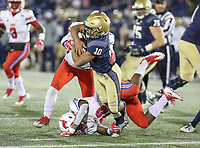 Annapolis, MD - November 11, 2017: Navy Midshipmen running back Malcolm Perry (10) gets tackled during the game between SMU and Navy at  Navy-Marine Corps Memorial Stadium in Annapolis, MD.   (Photo by Elliott Brown/Media Images International)