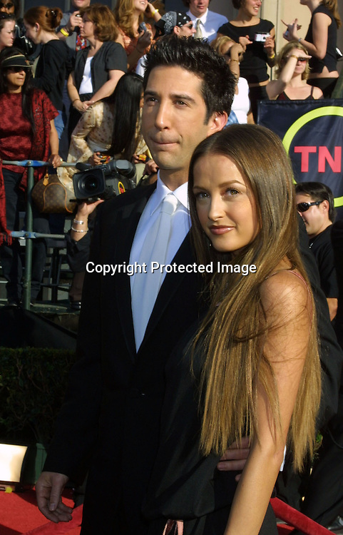©2003 KATHY HUTCHINS/HUTCHINS PHOTO.9TH ANNUAL SCREEN ACTORS GUILD AWARDS.SHRINE EXPOSITION CENTER.LOS ANGELES, CA  3/9/03.DAVID SCHWIMMER WITH HIS DATE
