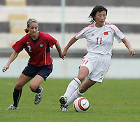 MAR 9, 2006: Faro, Portugal:  USWNT defender (2) Heather Mitts keeps close to China midfielder (11) Lili Bai at the Algarve Cup in Faro, Portugal. Mandatory Credit: Photo By Brad Smith-International Sports Images. (c) Copyright 2006 Brad Smith