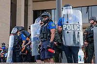 AUSTIN, TEXAS - MAY 30 An Austin Police officer armed with pepper spray stands guard during the Black Lives Matter protest at APD Headquarters on May 30, 2020 in downtown Austin, Texas<br /> <br /> Use of this image in advertising or for promotional purposes is prohibited.<br /> <br /> Editorial Credit: Photo by Dan Herron / Herron Stock