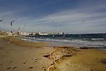 Wind surfers and wind kites on El Medano beach. El Medano, Tenerife, Canary Islands.