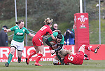 Ireland flanker Paula Fitzpatrick is tackled by Welsh pair Elinor Snowsill and Rachel Taylor.<br /> 6 Nations Championship<br /> Wales v Ireland Women<br /> St Helens Swansea<br /> 15.03.15<br /> &copy;Steve Pope - SPORTINGWALES