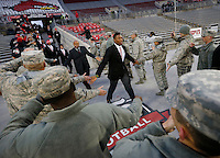 Ohio State Buckeyes linebacker Joshua Perry high fives U.S. Army National Guard members while entering the stadium as part of Military Appreciation Night prior to the NCAA football game at Ohio Stadium on Nov. 1, 2014. (Adam Cairns / The Columbus Dispatch)