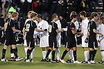 11 December 2009: Virginia (in white) and Wake Forest (in black) starters shake hands before the game. The University of Virginia Cavaliers defeated the Wake Forest University Demon Deacons 2-1 after overtime at WakeMed Soccer Stadium in Cary, North Carolina in an NCAA Division I Men's College Cup Semifinal game.