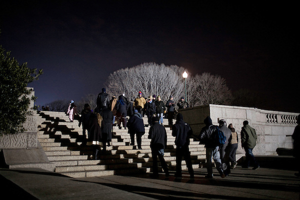 January 20, 2009. Washington, DC..Almost 2 million people packed the National Mall in sub freezing temperatures to witness the swearing in of Barack Obama, the 44th president of the united States and the first African American to hold the office. . Attendees make their way past the Capitol heading for the National Mall in the early morning.
