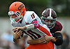 Dominic Rutigliano #10, Carey quarterback, gets sacked by Andrew DeSantis #42 of Garden City in the first quarter of a Nassau County Conference II varsity football game played at Garden City High School on Saturday, Oct. 14, 2017.