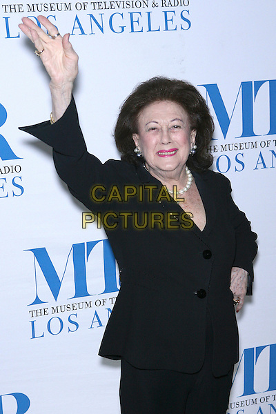 LUCY JARVIS.Launch party for the second year of MTR?s She Made It: Women Creating Television and Radio - Arrivals held at the Museum of Television & Radio, Beverly Hills, California, USA..December 5th, 2006.half length black jacket hand arm in air waving.CAP/ADM/ZL.©Zach Lipp/AdMedia/Capital Pictures