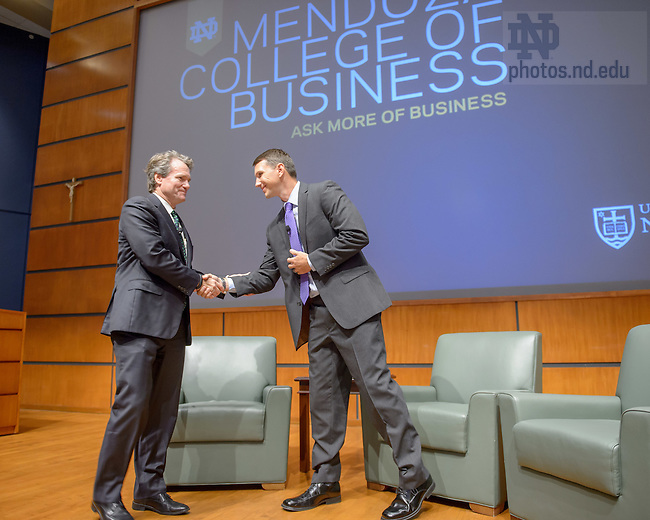 Sept. 18, 2015; Brian Moynihan, CEO of Bank of America, greets MBA student Christopher Boese before a panel discussion-style interview in the Jordan Auditorium.  The event was part of the Boardroom Inisghts lecture series. (Photo by Matt Cashore/University of Notre Dame)