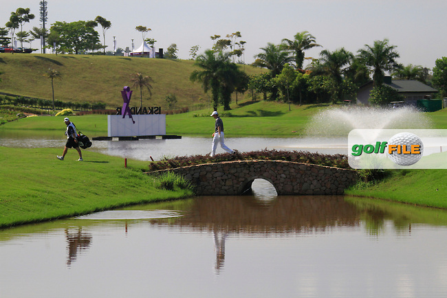 Michael Hoey (NIR) crosses a footbridge on the 18th hole during Saturday's storm delayed conclusion of Round 2 of the Iskandar Johor Open 2011 at the Horizon Hills Golf Resort Johor, Malaysia, 19th November 2011 (Photo Eoin Clarke/www.golffile.ie)