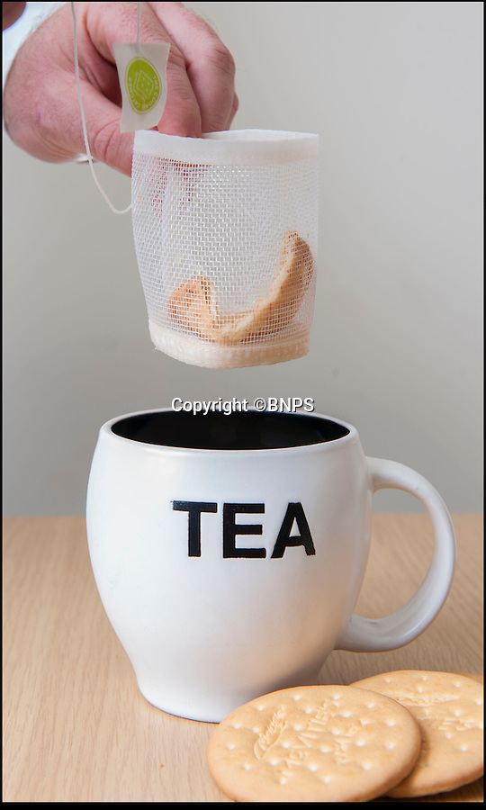 BNPS.co.uk (01202 558833)<br /> Pic: PhilYeomans/BNPS<br /> <br /> Finally...An end to the Tea-break terror...<br /> <br /> Problem solved...<br /> <br /> Tea drinkers are rejoicing after a nifty device designed to catch crumbs left by dunking biscuits in your brew hit the shelves.<br /> <br /> Dad of two Andrew Tinsley solved the age-old problem with a canny mesh pouch which sits inside a mug of tea collecting any unwanted biscuit bits that might float off during dunking.<br /> <br /> And should your Digestive or Rich Tea become too soggy and break off altogether this cheap and cheerful gadget will guarantee drinkers are not left with a heap of biscuity sludge at the bottom of their cup.<br /> <br /> Entrepreneur Andrew, 49, dreamed up the product, called the Cookie Catcher, after watching family members lose their sodden biscuits in their tea after dunking them for too long during Christmas celebrations last year.