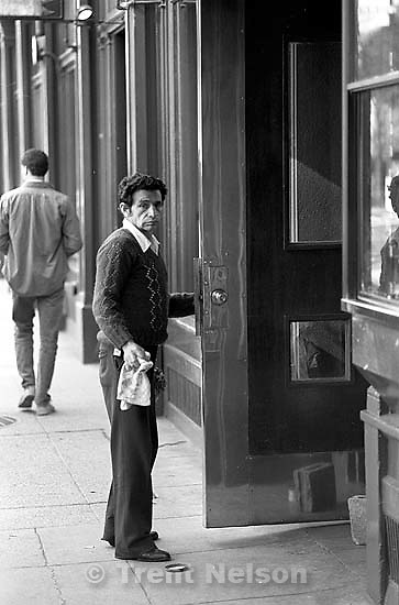 Man polishing door.<br />
