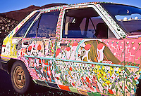 A trippy psychedelic Maui cruiser car at 9,700 feet in Haleakala National Park, Maui; the summit is to the upper left and the observatories including Mees Solar Observatory is to the upper right.