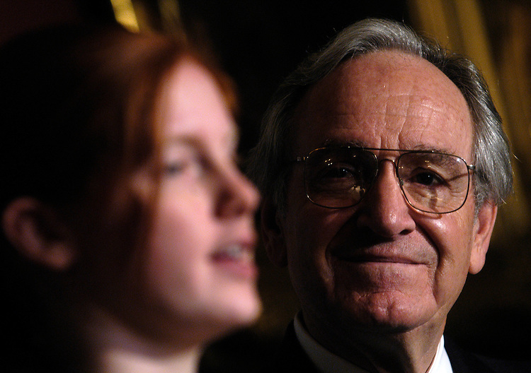 "Sen. Tom Harkin, D-Ia., watches Samantha Pickard, from Waterloo, Ia., at news conference on ""harsh cuts"" in funding for education and healthcare spending in President Bush's FY2007 budget request and the effect those cuts will have on people like Samantha, whose education is threatened..."
