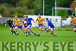 Kieran Doona Laune Rangers makes a break with Liam Carey  Beaufort in hot pursuit during the Mid Kerry clash in Killorglin on Sunday