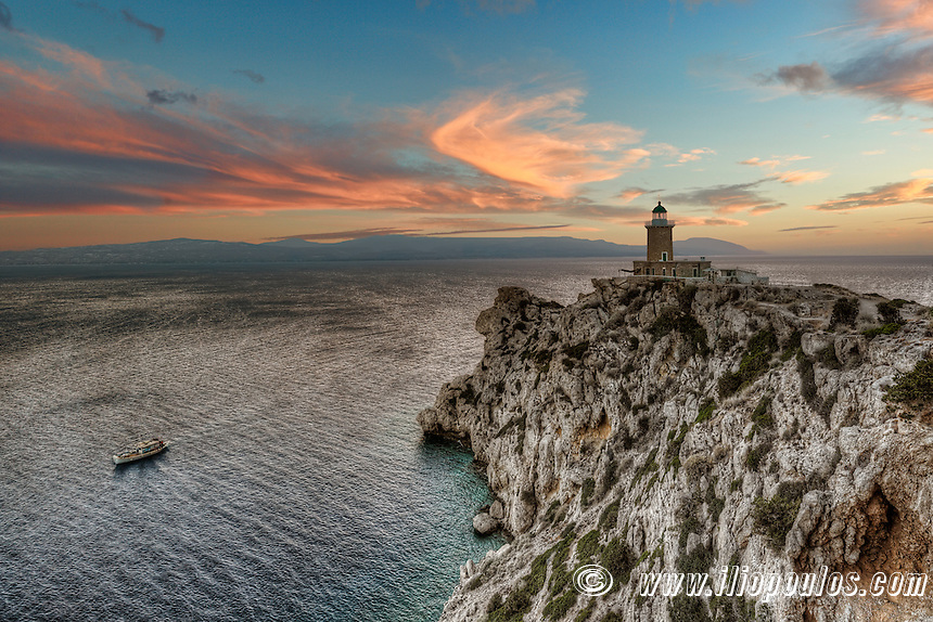 Sunset at Cape Melagavi Lighthouse in Corinthia, Greece
