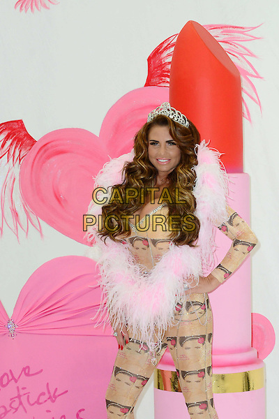 Katie Price (aka Jordan)<br /> At a photocall to launch her autobiography - 'Love, Lipstick And Lies' at The Worx, London, England.<br /> October 22nd, 2013<br /> half length leotard catsuit cover print crown tiara  beige silver pink fur tube book hand on hip cleavage     <br /> CAP/BF<br /> &copy;Bob Fidgeon/Capital Pictures